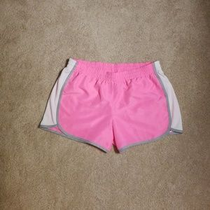 NWOT pink running shorts in a size Medium.